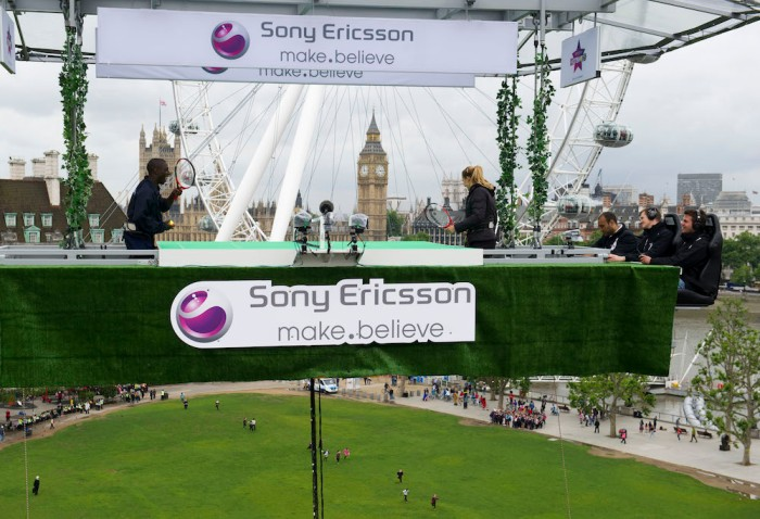 Alize Cornet, Xperia Hot Shot tennis player, swaps tips with Darius Knight, top British table tennis player, at Sony Ericsson's Tennis in the Sky on a specially constructed court suspended at 150ft over the Thames at Jubilee Gardens Waterloo London today while Pat Cash umpires.