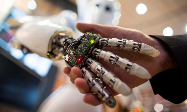robot shakes hands with human