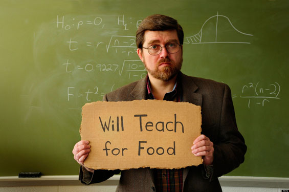 Professor or teacher in classroom holding a Will Work for Food sign. Statistical formula on chalkboard in background